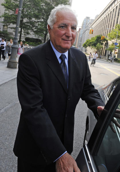 FILE - In this June 21, 2011 file photo, Daniel Bonventre, former director of operations at Bernard L. Madoff Investment Securities, leaves Manhattan federal court in New York. Bonventre and four other back-office subordinates of the Ponzi king go to trial Tuesday, Oct. 8, 2013 as the government for the first time shows a jury what it has collected in its five-year probe of one of history's biggest frauds. (AP Photo/Louis Lanzano, File)