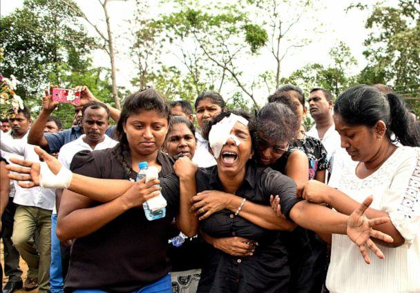 PHOTO: Anusha Kumari weeps during a mass burial for her husband, two children and three siblings, all victims of Easter Sunday bomb blast in Negombo, Sri Lanka, April 24, 2019. (Gemunu Amarasinghe/AP)