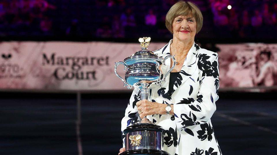 Margaret Court holds a trophy at the Australian Open in 2020.