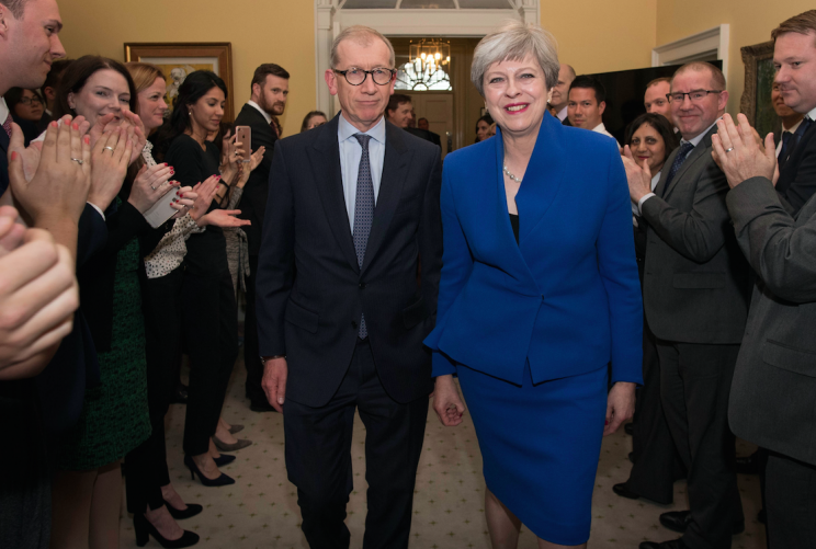 Mrs May and her husband Philip put a brave face on things during their return to Number 10 (Picture: PA)