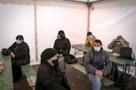 People wait for a medical examination outside the Clinic for Infectious and Tropical Diseases in Belgrade