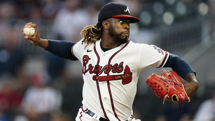 Atlanta Braves starting pitcher Touki Toussaint (62) works against the Colorado Rockies in the first inning of a baseball game Tuesday, Sept. 14, 2021, in Atlanta. (AP Photo/John Bazemore)