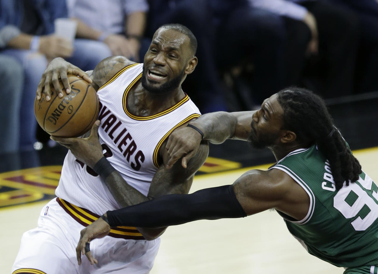 Cleveland Cavaliers' LeBron James (23) goes up for a shot against Boston Celtics' Jae Crowder (99) during the second half of Game 4 of the NBA basketball Eastern Conference finals, Tuesday, May 23, 2017, in Cleveland. The Cavaliers won 112-99. (AP Photo/Tony Dejak)