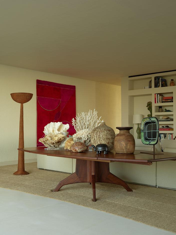 Shells, corals, and ceramics are displayed on a John Nyquist table from JF Chen.
