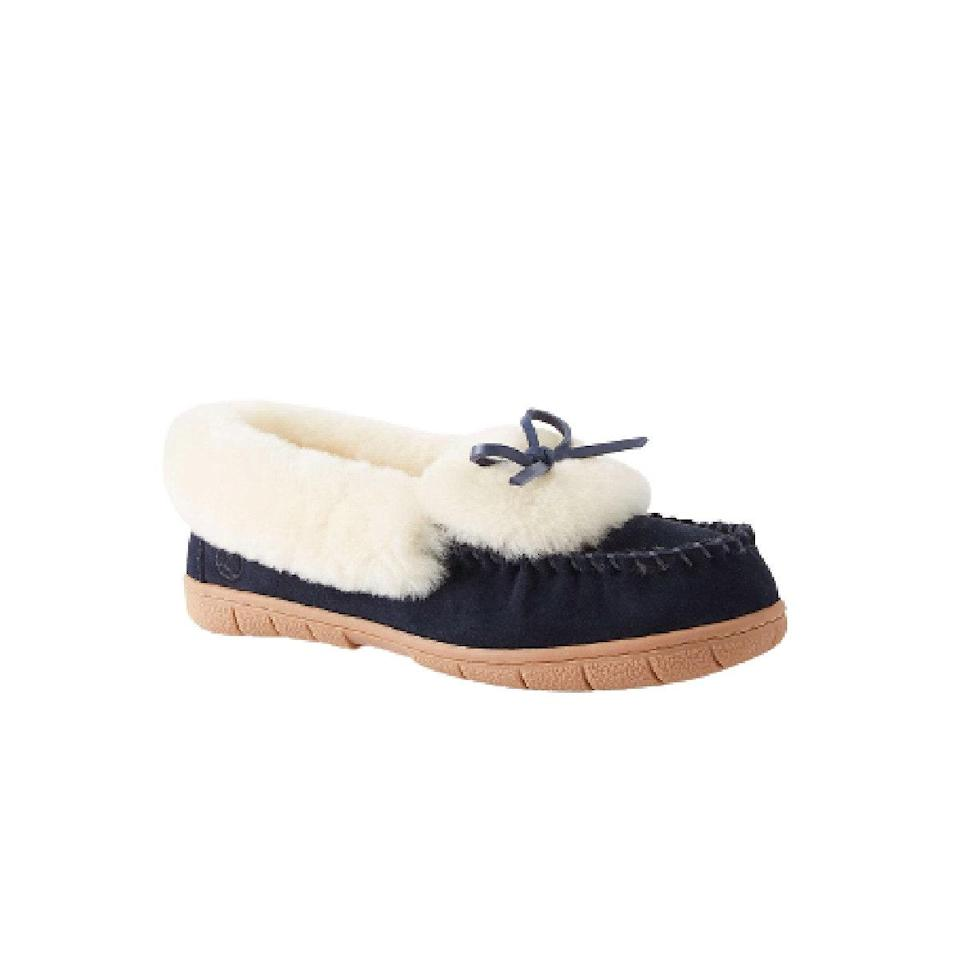 """The limit does not exist for how many shearling <a href=""""https://www.glamour.com/gallery/best-slippers-for-women?mbid=synd_yahoo_rss"""" rel=""""nofollow noopener"""" target=""""_blank"""" data-ylk=""""slk:slippers"""" class=""""link rapid-noclick-resp"""">slippers</a> she can own. $75, Draper James. <a href=""""https://draperjames.com/products/draper-james-x-lands-end-shearling-slippers-in-navy"""" rel=""""nofollow noopener"""" target=""""_blank"""" data-ylk=""""slk:Get it now!"""" class=""""link rapid-noclick-resp"""">Get it now!</a>"""