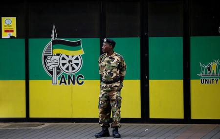 FILE PHOTO: A member of the Umkhonto We Sizwe Military Veterans Association (MKMVA) stands guard at the ANC headquarters in downtown Johannesburg, South Africa, September 5, 2016. REUTERS/Siphiwe Sibeko/File Photo