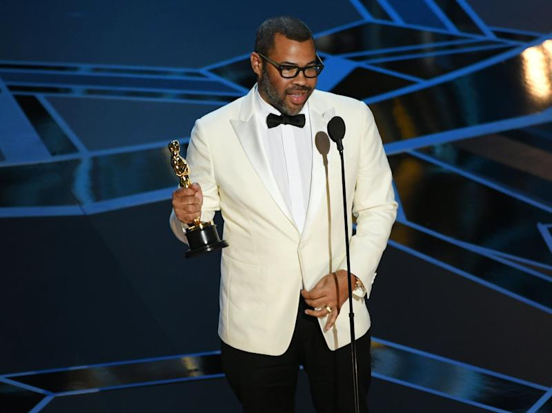"Jordan Peele accepts the award for Best Original Screenplay for ""Get Out."""