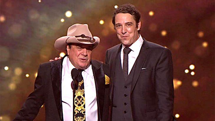 Samuel Johnson won best actor for portraying Molly Meldrum (pictured, right) and dedicated his speech to his sister Connie. Photo: Channel Nine