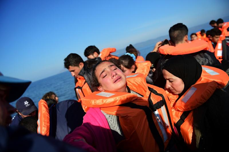 A girl cries as she arrives along with other migrants and refugees, on the Greek island of Lesbos, after crossing the Aegean Sea from Turkey, on November 18, 2015