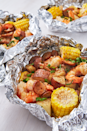 "<p>Easy clean-up!</p><p>Get the recipe from <a href=""https://www.delish.com/cooking/recipe-ideas/recipes/a47430/grilled-shrimp-foil-packets-recipe/"" rel=""nofollow noopener"" target=""_blank"" data-ylk=""slk:Delish"" class=""link rapid-noclick-resp"">Delish</a>.</p>"