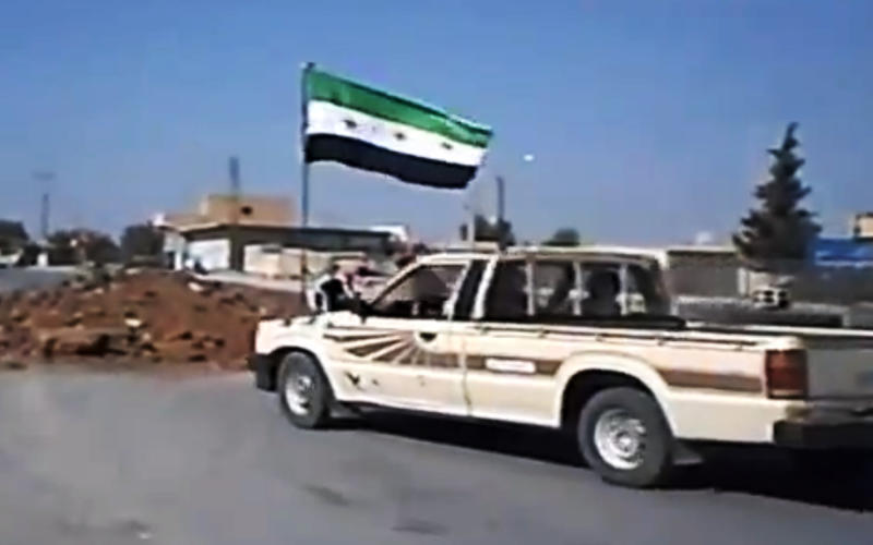 In this image taken from video obtained Wednesday, Sept. 19, 2012 from the Ugarit News, which has been authenticated based on its contents and other AP reporting, Free Syrian Army soldiers seize Ain al-Arous town in Raqqa, Syria, on Tuesday, Sept. 18, 2012. (AP Photo/Ugarit News via AP video)