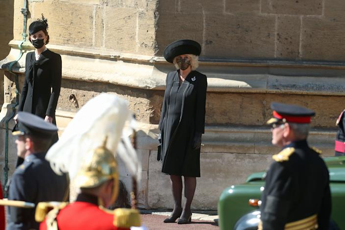 WINDSOR, ENGLAND - APRIL 17: The Duchess of Cambridge (L) and the Duchess of Cornwall watch the procession at the Galilee Porch at St George's Chapel during the funeral of Prince Philip, Duke of Edinburgh, at Windsor Castle on April 17, 2021 in Windsor, England. Prince Philip of Greece and Denmark was born 10 June 1921, in Greece. He served in the British Royal Navy and fought in WWII. He married the then Princess Elizabeth on 20 November 1947 and was created Duke of Edinburgh, Earl of Merioneth, and Baron Greenwich by King VI. He served as Prince Consort to Queen Elizabeth II until his death on April 9 2021, months short of his 100th birthday. His funeral takes place today at Windsor Castle with only 30 guests invited due to Coronavirus pandemic restrictions. (Photo by Steve Parsons - WPA Pool/Getty Images)
