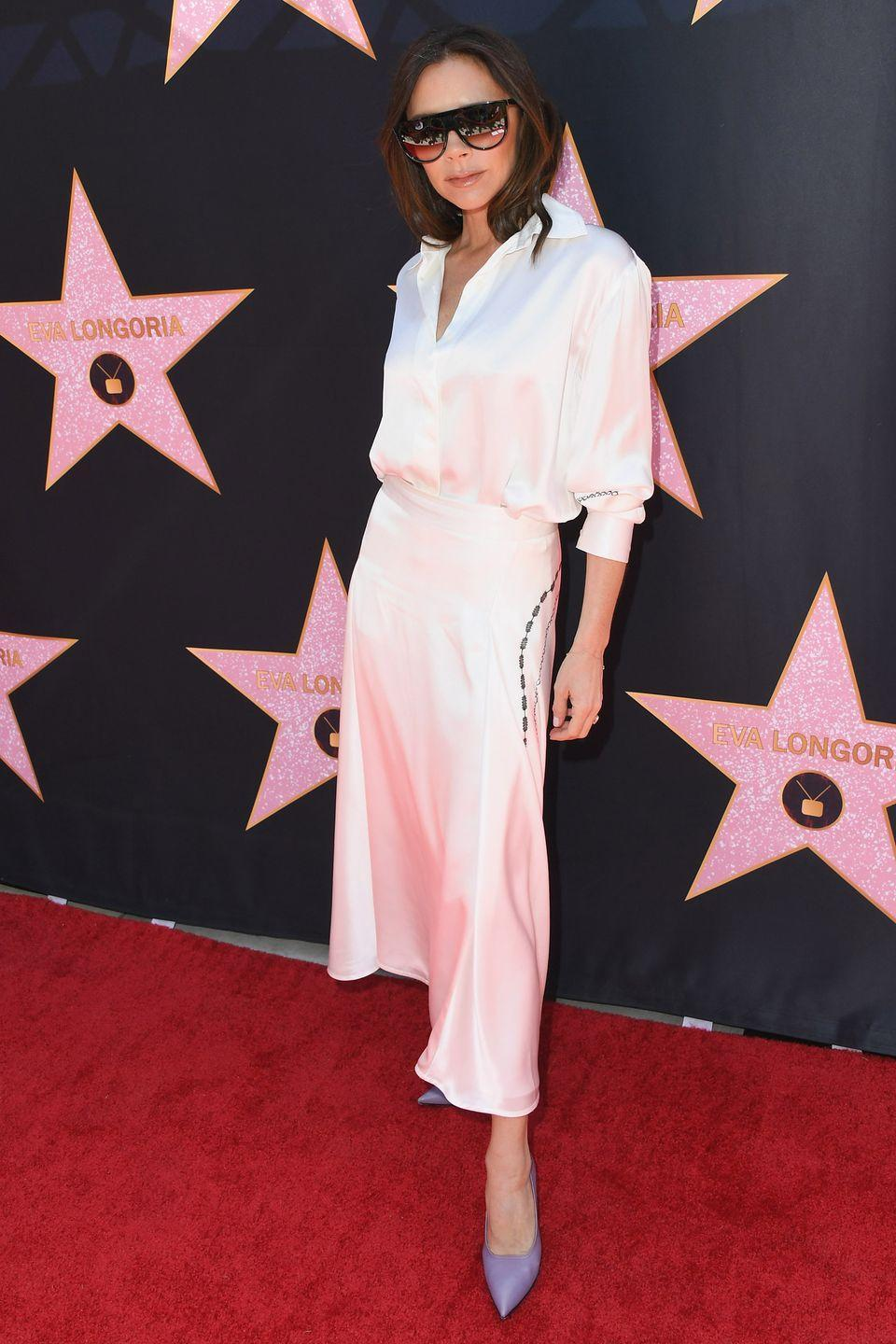 <p>Take your cue from Victoria Beckham and team slinky silk skirts with colourful heels and simple white shirts.</p>