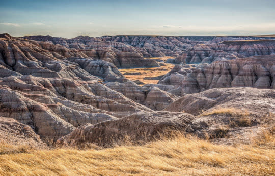 "<p><a href=""https://www.theconstantrambler.com/ramblin-guide-to-rapid-city-sd-from-the-badlands-rushmore-sturgis-custer/"" rel=""nofollow noopener"" target=""_blank"" data-ylk=""slk:Badlands National Park in South Dakota"" class=""link rapid-noclick-resp"">Badlands National Park in South Dakota</a> stands out as one of our favorite places in America. The landscape changes with the light and no two visits are ever the same. <i>—Kenin and Lauren Bassart, <a href=""http://www.theconstantrambler.com/"" rel=""nofollow noopener"" target=""_blank"" data-ylk=""slk:The Constant Rambler"" class=""link rapid-noclick-resp"">The Constant Rambler</a></i></p>"