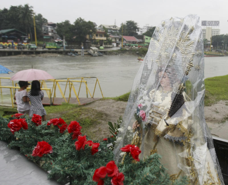 The image of Our Lady of the Abandoned is prepared for a procession to a Catholic church at Marikina city, east of Manila, Philippines during a ceremony to commemorate the wrath of typhoon Ketsana (local name Ondoy) which caused the worst flooding in decades of metropolitan Manila and killed more than 500 people exactly two years ago Monday Sept. 26, 2011. Also on Monday, the Philippines is bracing for a new typhoon Nesat, with winds of up to 133 miles (215 kilometers) per hour,  which is forecast to make a landfall in northeastern part of the country Tuesday. (AP Photo/Bullit Marquez)