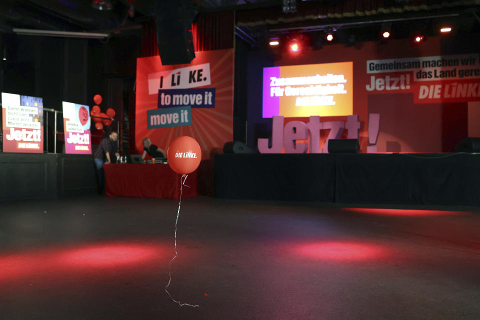 A balloon floats through the hall of the election party of Die Linke in the Karl-Liebknecht-Haus after everyone has left in Berlin, Sunday, Sept. 26, 2021. Exit polls show the center-left Social Democrats in a very close race with outgoing Chancellor Angela Merkel's bloc in Germany's parliamentary election, which will determine who succeeds the long-time leader after 16 years in power. (Jan Woitas/dpa via AP)