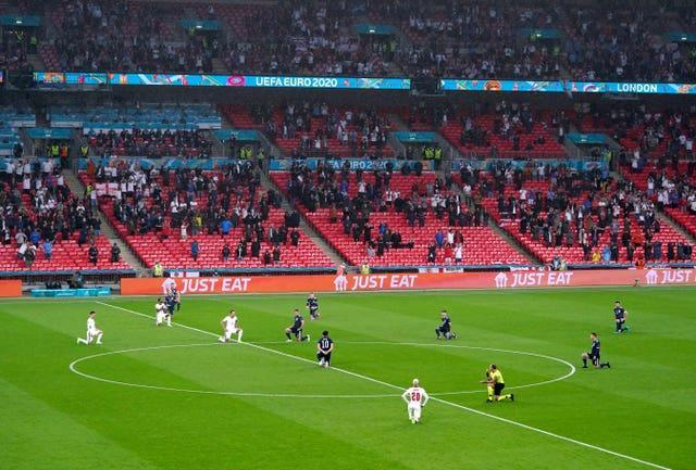 England and Scotland players take a knee ahead of the game at Wembley