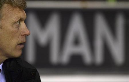 Manchester United's manager David Moyes awaits the start of their English League Cup semi-final first leg soccer match against Sunderland at the Stadium of Light in Sunderland, northern England January 7, 2014. REUTERS/Nigel Roddis