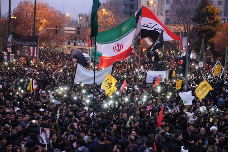 Iranians gather in the northeastern city of Mashhad on January 5, 2020 to pay homage to top general Qasem Soleimani and others after they were killed in a US strike. Source: Getty