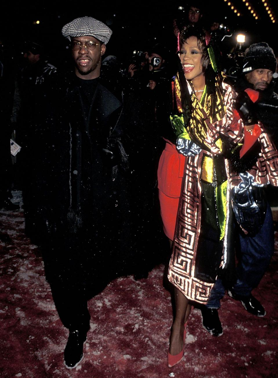 """<p>The late icon, whose song """"Exhale (Shoop Shoop)"""" was the lead single on the film's soundtrack, arrived looking radiant, draped in a metallic, multicolored shawl alongside her then-husband. </p>"""