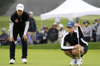Matilda Castren, of Finland, right, and Min Lee, line up their putts on the ninth green at Lake Merced Golf Club during the final round of the LPGA Mediheal Championship golf tournament Sunday, June 13, 2021, in Daly City, Calif. (AP Photo/Tony Avelar)