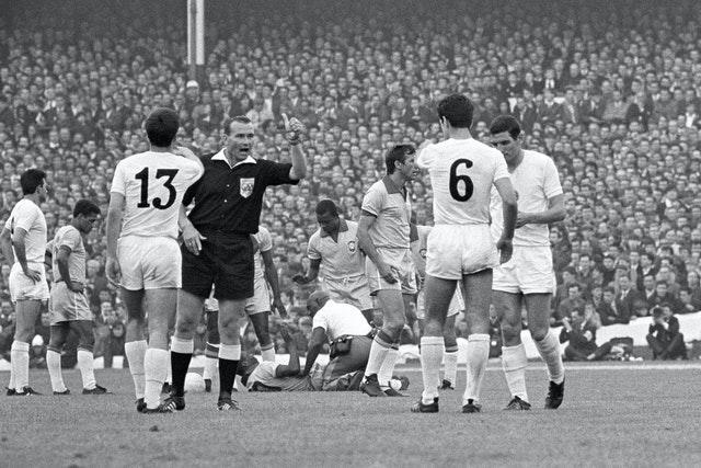 Pele (on floor) receives treatment from trainer Americo (kneeling) as referee Kurt Tschenscher (second left) warns Bulgaria's Dimitar Yakimov (13) and Dobromir Jetchev (6) (PA)