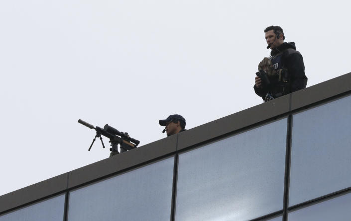 Police marksmen man the roof of Christchurch High Court as family and survivors from the March 2019 Christchurch mosque shootings arrive for the sentencing of 29-year-old Australian Brenton Harrison Tarrant, in Christchurch, New Zealand, Monday, Aug. 24, 2020. Tarrant has pleaded guilty to 51 counts of murder, 40 counts of attempted murder and one count of terrorism in the worst atrocity in the nation's modern history. (AP Photo/Mark Baker)