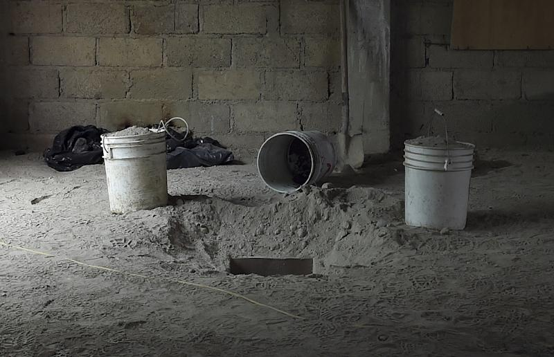 """The alleged end of the tunnel through which Mexican drug lord Joaquin """"El Chapo"""" Guzman could have escaped from the Altiplano prison, is seen at a house in Almoloya de Juarez, Mexico, on July 12, 2015 (AFP Photo/Yuri Cortez)"""