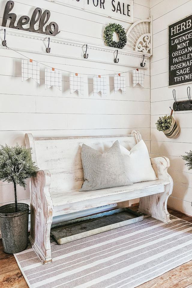 """<p>Give your guests a hint at what's to come by putting together a warm and inviting entryway full of farmhouse-inspired accents, including shiplap, whitewashed furniture, and galvanized planters. </p><p><strong>RELATED: </strong><a href=""""https://www.goodhousekeeping.com/home/decorating-ideas/g30363189/entryway-ideas/"""" target=""""_blank"""">Stylish Entryway Ideas </a></p>"""