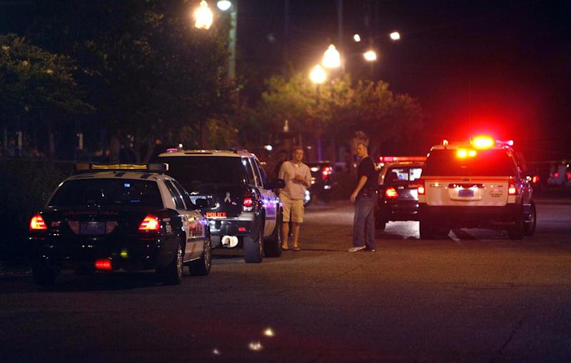 Tuscaloosa Police responded to the scene of a shooting early Tuesday morning July 17, 2012 in downtown Tuscaloosa, Ala., after a gunman who opened fire outside a crowded bar, wounding 17 people. Police were still searching for a suspect. (AP Photo/Tuscaloosa News, Robert Sutton)