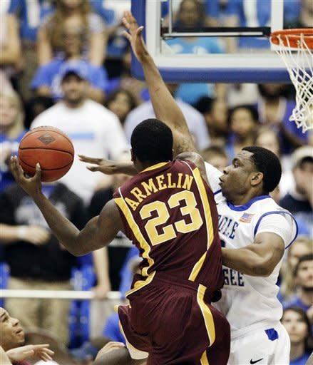 Minnesota guard Chip Armelin (23) drives against Middle Tennessee forward Shawn Jones, right, in the first half of a quarterfinal NIT college basketball tournament game on Wednesday, March 21, 2012, in Murfreesboro, Tenn. (AP Photo/Mark Humphrey)