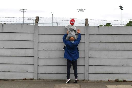 No peeking: While fans tried to get a glimpse of Liverpool training, police want them to stay away from the Merseyside derby