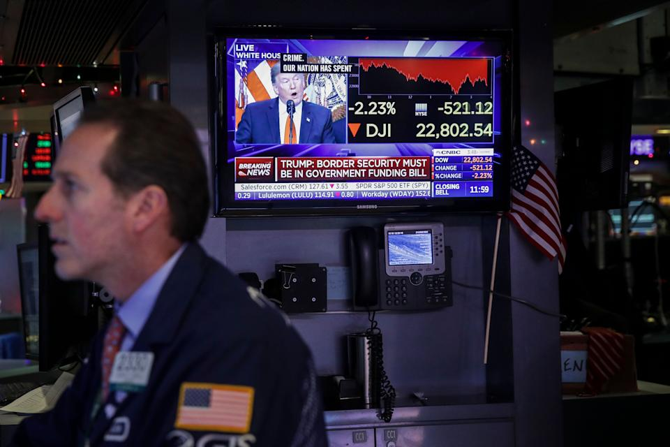 NEW YORK, NY - DECEMBER 20: President Donald Trump is displayed on a monitor as a trader works at his desk ahead of the closing bell on the floor to he New York Stock Exchange (NYSE), December 20, 2018 in New York City. The Dow Jones industrial average continued its tumultuous week, closing down over 460 points on Thursday, one day after the Federal Reserve raised the interest rate. (Photo by Drew Angerer/Getty Images)