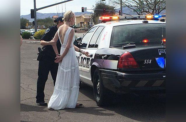 Amber Young, 32, was driving herself to her wedding on Monday when she was cuffed and arrested by police for drink driving. Source: Marana Police Department / Twitter