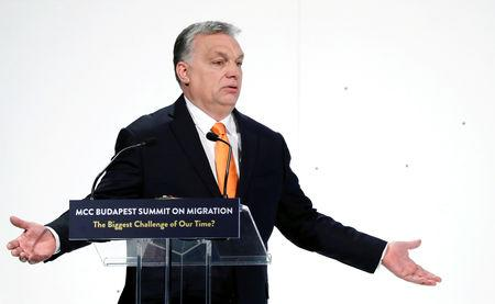 FILE PHOTO: Hungarian Prime Minister Viktor Orban speaks at a migration summit in Budapest