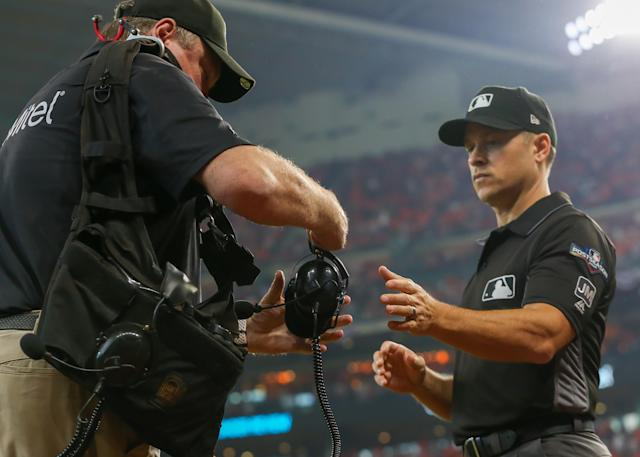 Umpire Mark Wegner reviewed a play using MLB's replay review system during Game 1 of the 2019 ALDS between the Tampa Bay Rays and Houston Astros. (Photo by Leslie Plaza Johnson/Icon Sportswire via Getty Images)
