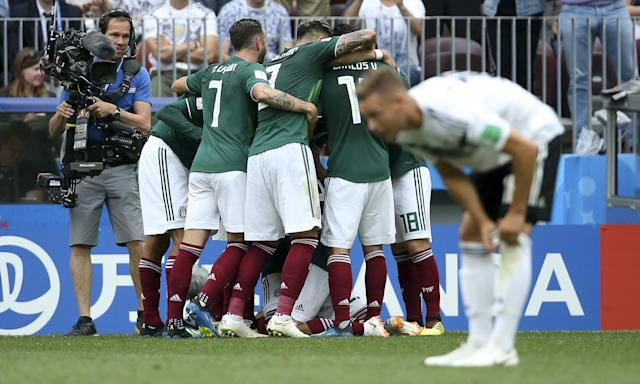 Hirving Lozano of Mexico celebrates his winning goal against Germany, who struggled against their opponents' high press.
