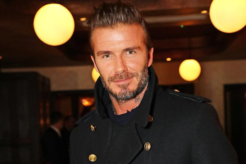 Beckham was awarded the honour for his glittering career: Dave Benett