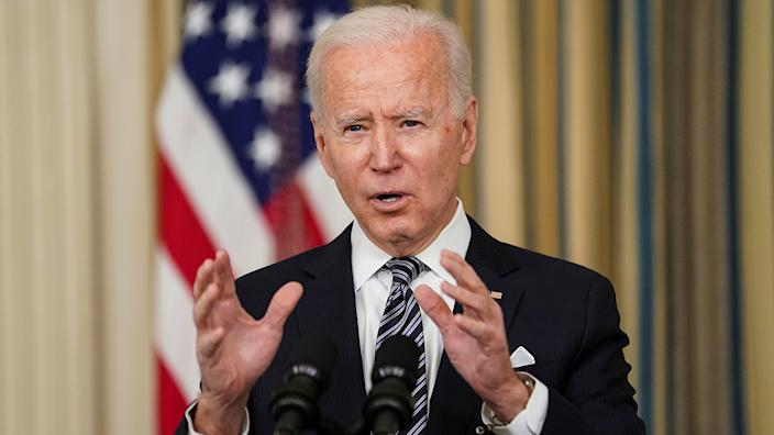 U.S. President Joe Biden delivers remarks on the implementation of the American Rescue Plan in the State Dining Room at the White House in Washington, U.S., March 15, 2021. REUTERS/Kevin Lamarque