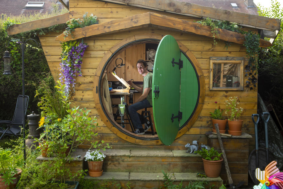 Ali Hughson has built a Lord of the Rings themed Hobbit House as a workshop in his back garden. (SWNS) Hughson fulfilled his childhood dream by building a Hobbit house as a workshop. (SWNS)