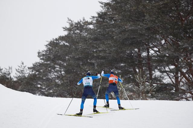 Oleksandr Kazik of Ukraine and his guide Sergiy Kucheryaviy compete in the Biathlon Visually Impaired Men's 15km at the Alpensia Biathlon Centre. The Paralympic Winter Games, PyeongChang, South Korea, Friday 16th March 2018. OIS/IOC/Simon Bruty/Handout via Reuters