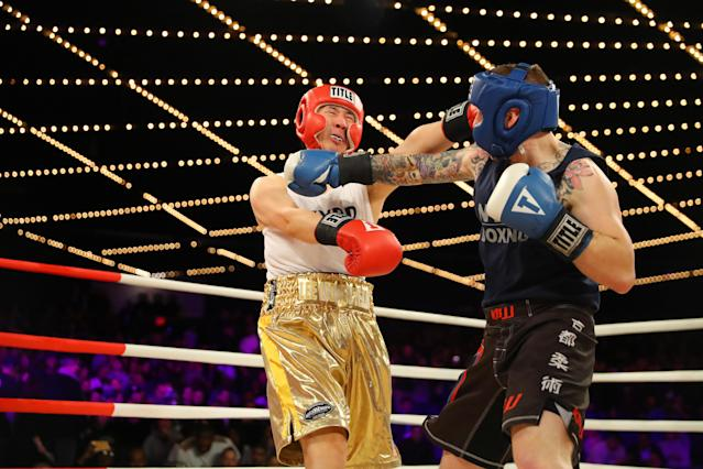 <p>Willie Lee (red) fights Kevin Wind (blue) in the 5th Precinct Grudge Match at the NYPD Boxing Championships at the Hulu Theater at Madison Square Garden on March 15, 2018. (Gordon Donovan/Yahoo News) </p>