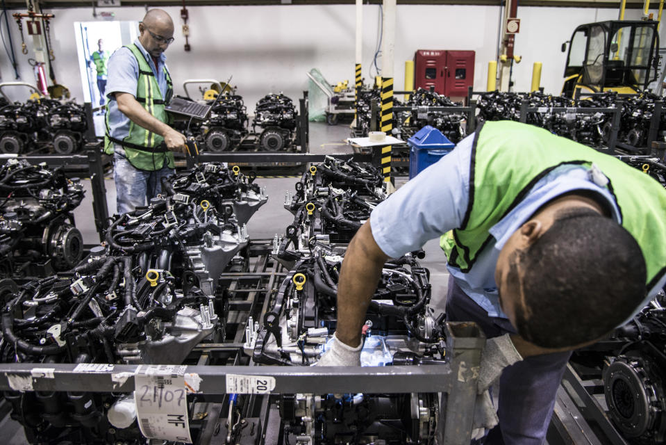 Employees check on quality control and inspection at FORD Engines plant in Camaçari, State of Bahia, Brazil on Monday, July 27th, 2015 (Photo by Paulo Fridman/Corbis via Getty Images)