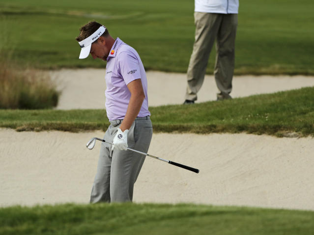 Ian Poulter, of England, reacts after a shot out of the bunker on the ninth hole during the second round of the U.S. Open Golf Championship. (AP)