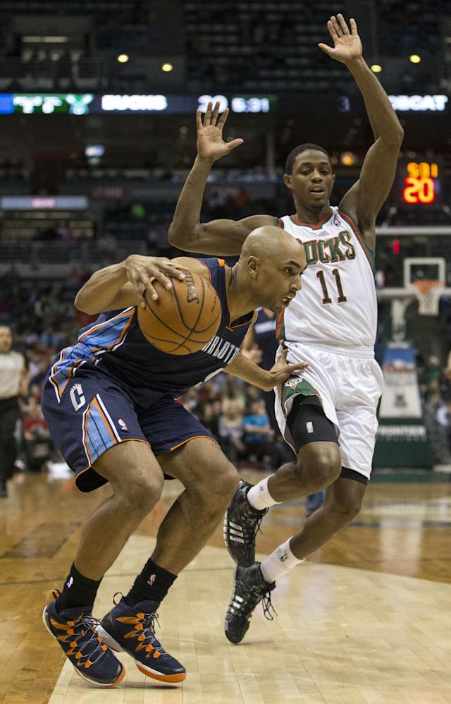 Milwaukee Bucks' Brandon Knight, right, is called for a foul while trying to defend against Charlotte Bobcats' Gerald Henderson during the first half of an NBA basketball game on Sunday, March 16, 2014, in Milwaukee. (AP Photo/Tom Lynn)
