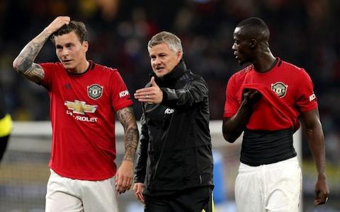 Manchester United Manager Ole Gunnar Solskjaer (centre) talks with Victor Lindelof (left) and Eric Bailly of Manchester United at half time during the Manchester United and Leeds United match - Credit: Rex Features