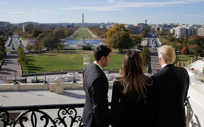 <p>Speaker of the House Paul Ryan shows Melania Trump and President-elect Donald Trump the Mall from the speaker's balcony on Capitol Hill in Washington, Nov. 10, 2016. (Joshua Roberts/Reuters) </p>