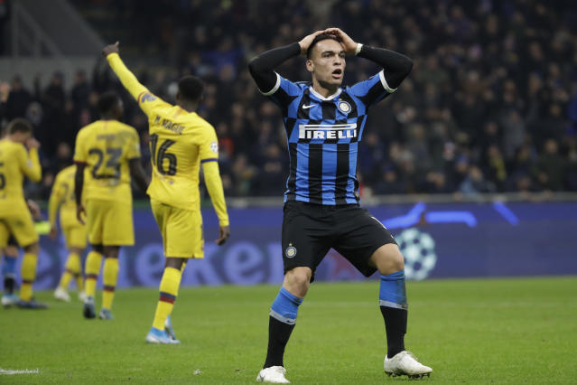 Inter Milan's Lautaro Martinez, right, reacts after a missed scoring opportunity during the Champions League, group F soccer match between Inter Milan and F.C. Barcelona, at the San Siro stadium in Milan, Italy, Tuesday, Dec. 10, 2019. (AP Photo/Luca Bruno)