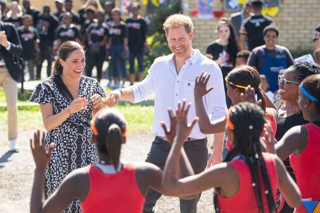 The Duke and Duchess of Sussex meeting a group of dancers at the Nyanga Township in Cape Town, South Africa, on the first day of their tour of Africa, which cost nearly £246,000