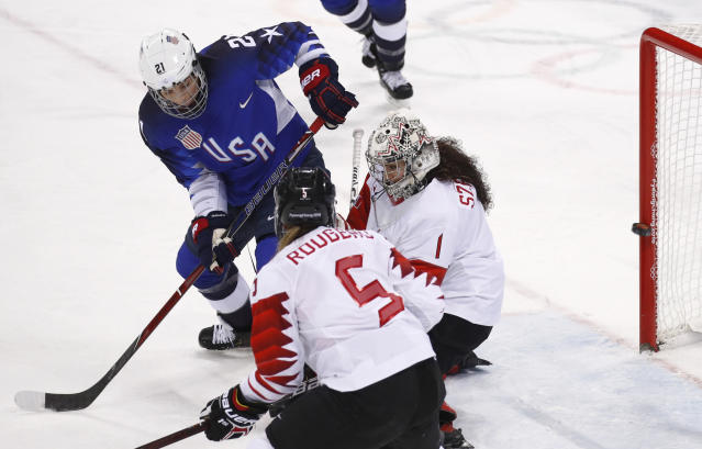Hilary Knight (21), of the United States, shoots the puck past goalie Shannon Szabados (1), of Canada, for a goal during the first period of the women's gold medal hockey game at the 2018 Winter Olympics in Gangneung, South Korea, Thursday, Feb. 22, 2018. (AP Photo/Jae C. Hong)